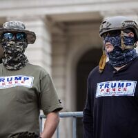 """Georgia Security Force militia members are seen at a """"Stop The Steal"""" rally at the state capitol. // Nathan Posner for the AJT."""