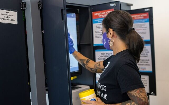 Ballot machine being sanitized after use on election day Nov 3. // Nathan Posner for the AJT.