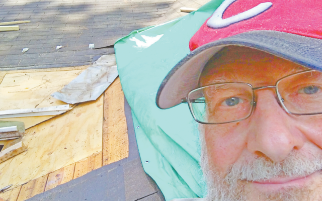 Dr. Yaffe helps fix a neighbor's roof.
