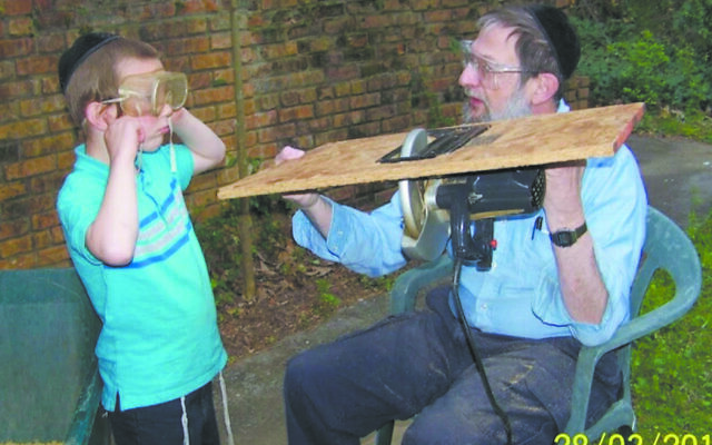 Dr. Yaffe shows his grandson how to convert one tool to another.