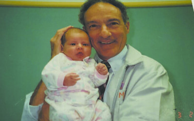 Pediatrician Dr. Mike Levine stands with one of his patients in 1994.