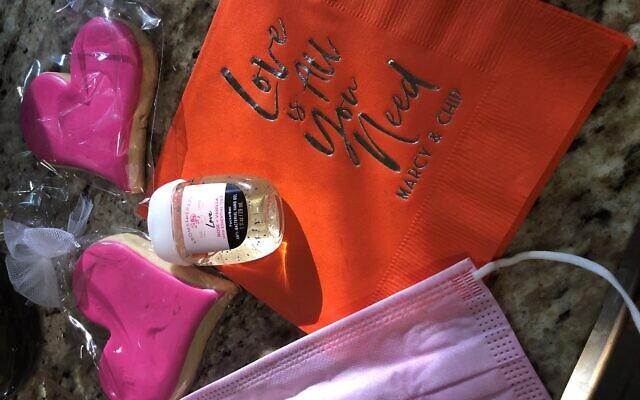 Guests got a COVID kit alongside custom heart cookies by Galu Sweet