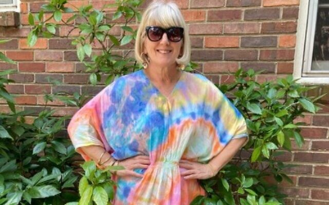 Dawn Siegel enjoys wearing her tie-dye caftan on Shabbat.
