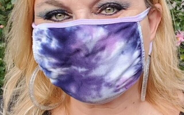 Jodi Wittenberg leads classes and tie-dye experiences in one of her multi-ply face masks.