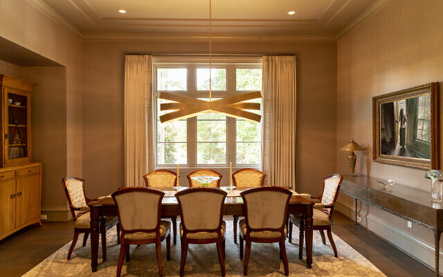 The glamorous dining room abounds in natural light and faces east.