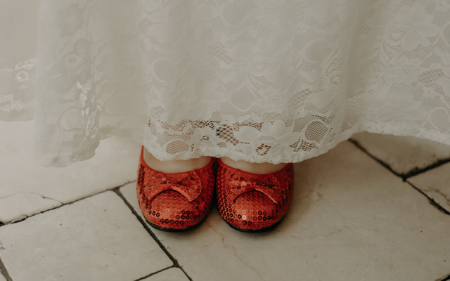 "Nathalia Frykman Photography // Anna Streetman wore ruby slippers with her dress, a tribute to ""The Wizard of Oz,"" a favorite during childhood when she met Harrison."