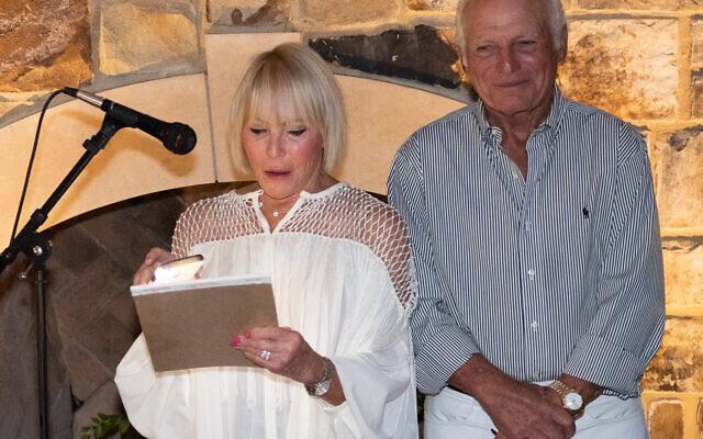 Brenda and Mark Lichtenstein toast the newlyweds.
