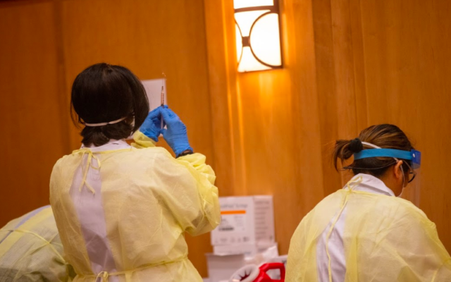 Health care workers prepare vaccinations for residents and staff of the Breman Home in Atlanta, Georgia on Dec. 29.