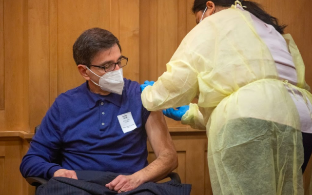 Harley Tabak, President and CEO of Jewish Home Life Communities, receives a vaccination for the Covid-19 disease at the Breman Home in Atlanta, Georgia on Dec. 29.