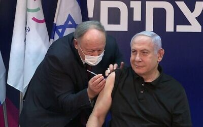 Netanyahu gets the COVID vaccine on Dec. 19.