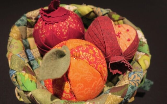 """Pomegranate Guild of Judaic Needlework Biennial Convention, Atlanta, May 2017.  """"Fabric Peaches and Pomegranates,"""" made by PSS members, are PGJN table centerpieces at their 2017 convention in Atlanta."""