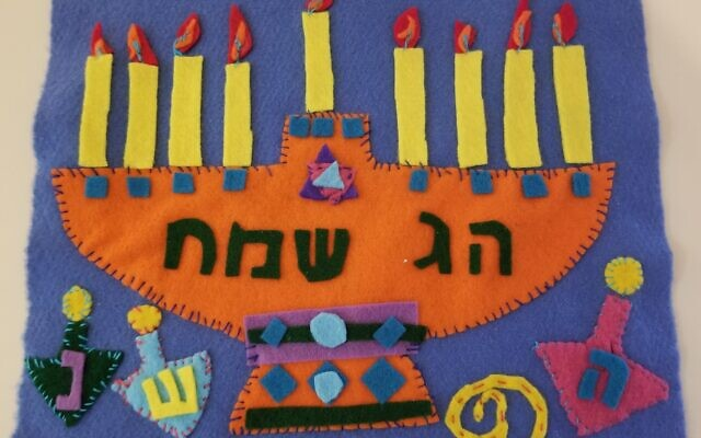 Felt cutouts with embroidery and blanket stitching becomes a small Chanukah wall hanging.