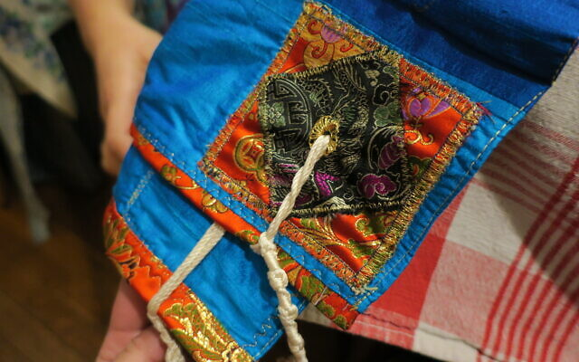 A prayer shawl, sewn by Sarah Jacobs, was given to her daughter.