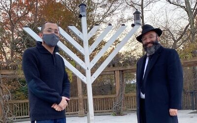 Shmaya Friedman joins Rabbi Isser New at the Beth Tefillah menorah lighting in Sandy Springs.