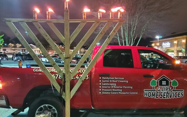 Zalmy Goldberg publicly celebrates Chanukah as he drives his truck around Atlanta.