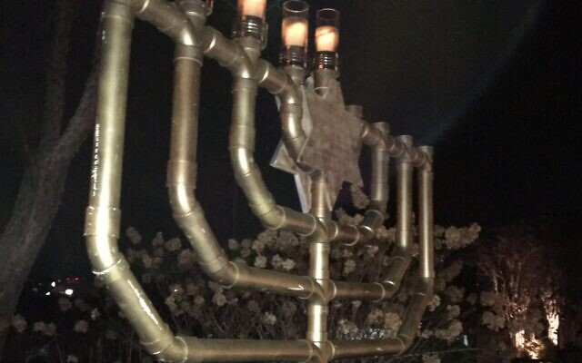Chabad of Cobb set up large menorot throughout the East Cobb area. And Congregation Etz Chaim lit its outdoor menorah, along with a traditional table-topper, Dec. 13. The menorah lighting ceremony was followed by Chanukah songs by engagement director Heather Blake on guitar.