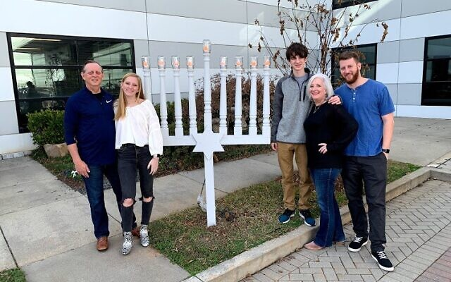 Adam Arno in front of the menorah with his family: Richard, Pearl, Adam, Sheryl and Eliot.