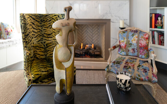 """The background Chinese dolls are from Alison's parents. The Kimo Minton sculpture GRACE II """"graces"""" the cocktail table. The Scalamandre chair fabric was chosen by late designer L. Benjamin Jones."""