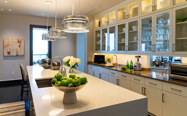 The backsplash is Calacatta Gold marble. The row of Mercury glass fixtures are indeed special.