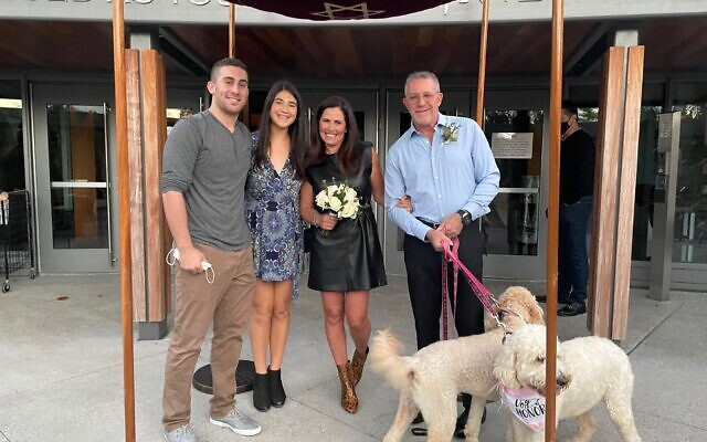 The wedding chuppah included golden doodle attendants Lacy and Kosmo.