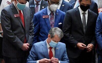 Gov. Brian Kemp signs historic hate crimes bill.