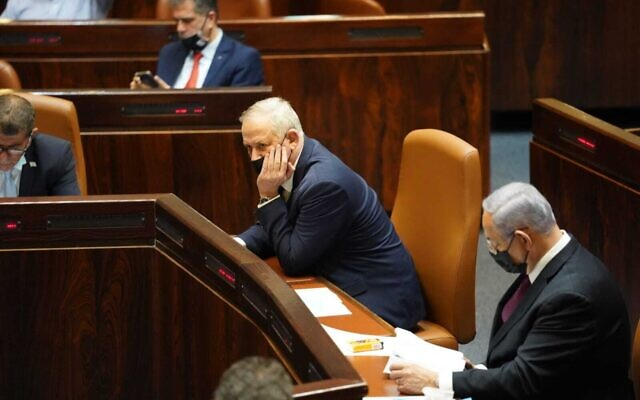 Benny Gantz, left, and Benjamin Netanyahu in the Knesset during a vote for the parliament to dissolve itself, on December 2, 2020. (Danny Shem Tov/ Knesset Spokesperson)
