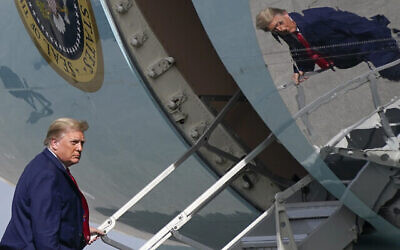 US President Donald Trump boards Air Force One at Palm Beach International Airport, Thursday, Dec. 31, 2020, in West Palm Beach, Fla. Trump is returning to Washington after visiting his Mar-a-Lago resort. (AP Photo/Patrick Semansky)