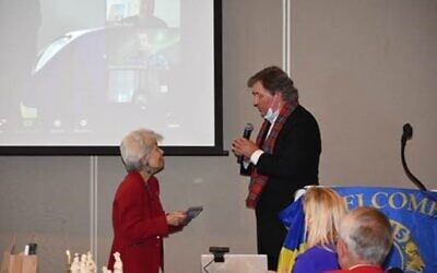 Marilyn Pearlman is recognized by Scott Rogers, president of the Atlanta Lions Club.