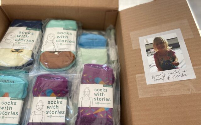 Participants in Resilience Gives' Paying it Forward Initiative donated over 5,800 pairs of socks to children's hospitals last year.