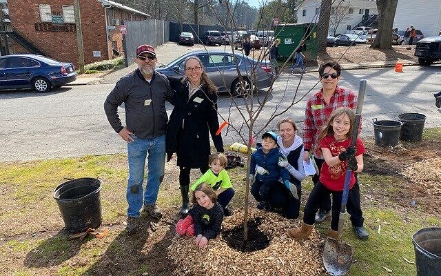 Members of The Temple plant trees at Atlanta's Lenox Park for Trees Atlanta's annual Tu B'Shevat event.