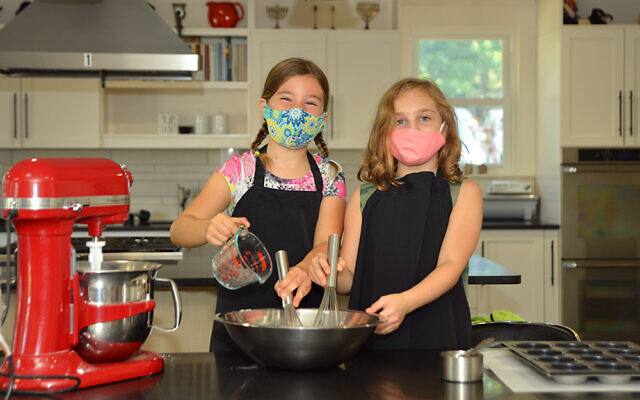 Jocelyn Hathaway and Maddie Baer  in the experimental kitchen in the MJCCA Kuniansky Family Center.