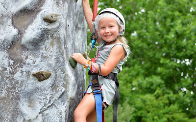 A camper from MJCCA Day Camps rock climbing.