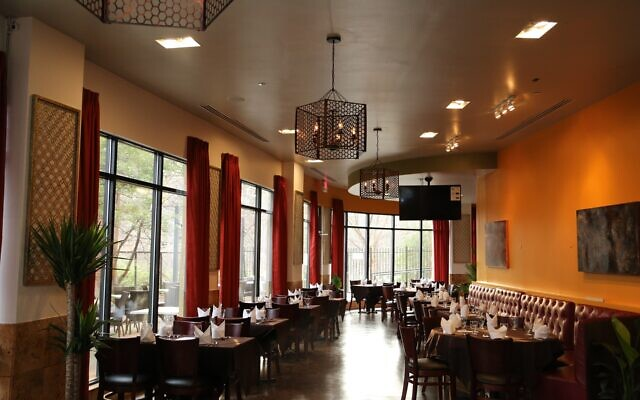 Inspired high ceilings and windows draped in tangerine have upscale vibes not usually associated with casual Indian food.