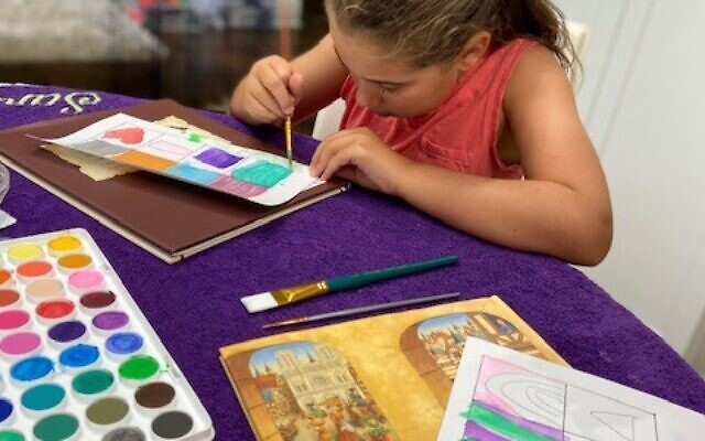 Art time at the Schapiro's home includes learning how to use watercolors and learning about lines and color mixing.