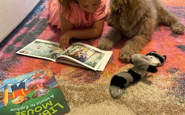 What fun it is to read aloud to the Schapiro's new puppy Cooper.