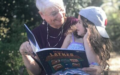 Nana Suellen Katz reads a story to granddaughter Melanie.