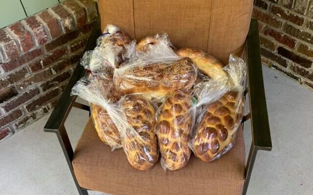 Challot by Jeff Weener await pickups on the baker's home porch every Friday afternoon.