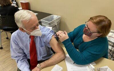 Dr. Stanley Fineman, an allergist and immunologist, received his first dose of the vaccine Dec. 22 and received his second dose Jan. 12 at Kennestone Hospital.