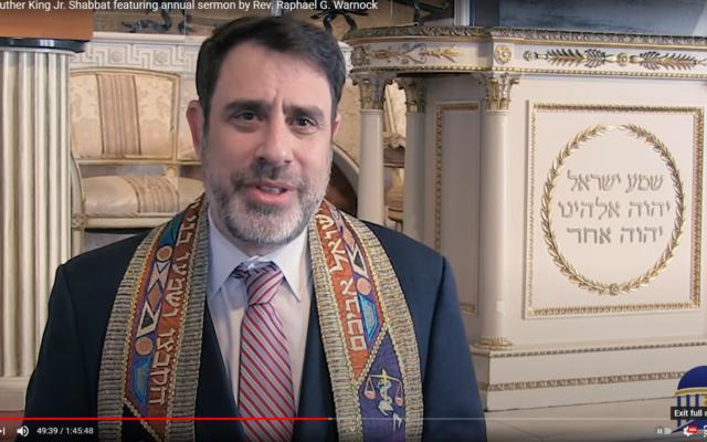 "Rabbi Peter Berg, senior rabbi at The Temple, praised Rev. Raphael Warnock as ""our preacher, my friend and teacher."""