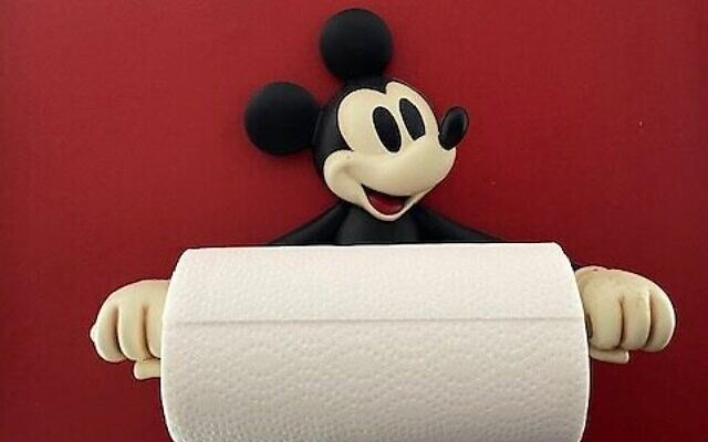 Solomon's favorite Disney kitchen item is this Mickey Mouse paper towel holder.