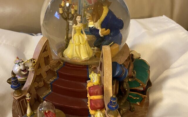A Beauty and the Beast snow globe from Solomon's collection.