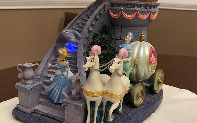 This large snow globe tells the entire Cinderella story. Note the blue slipper on the stairs.