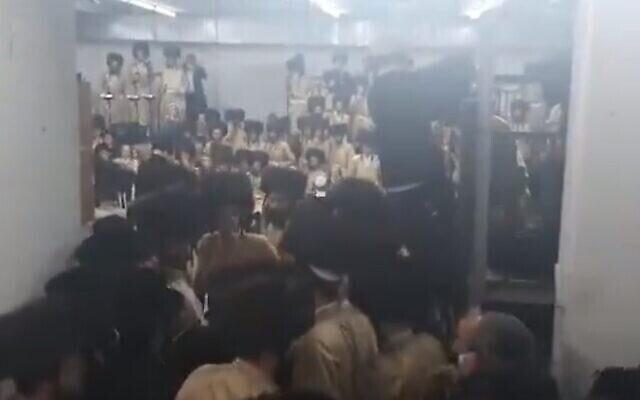 Hundreds of ultra-Orthodox men from the Toldos Aharon Hasidic dynasty attend a wedding in Beitar Illit, violating coronavirus regulations, January 5, 2021. (Screenshot: Twitter)