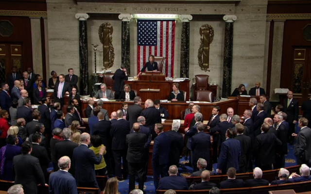 First Impeachment of Trump. US Speaker of the House Nancy Pelosi presides over Resolution 755, Articles of Impeachment Against President Donald J. Trump as the House votes at the US Capitol in Washington, DC. Image Credit: AP