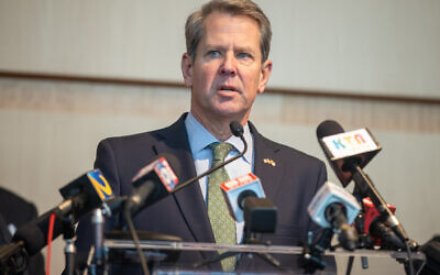 Gov. Brian Kemp hosts a press conference at the Georgia International Convention Center vaccination site in College Park Feb. 17.