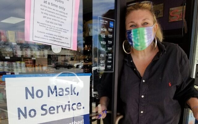 At The Spicy Peach's front door, co-owner Jodi Wittenberg gets ready to welcome customers.
