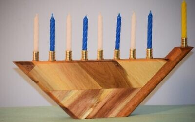 Pollack created this acacia butcher block menorah. He donated menorot to b'nai mitzvah students to celebrate Chanukah.