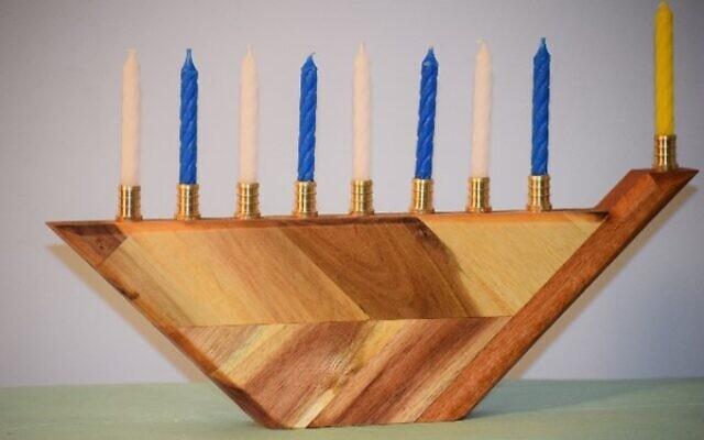Pollack created this acacia butcher block menorah. He donated menorot to b'nai mitzvah students to celebrate Chanukah.