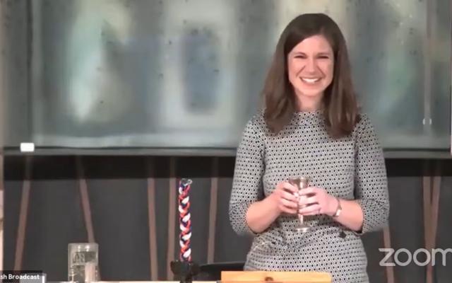 Rabbi Lauren Henderson blesses the wine during Havdalah.