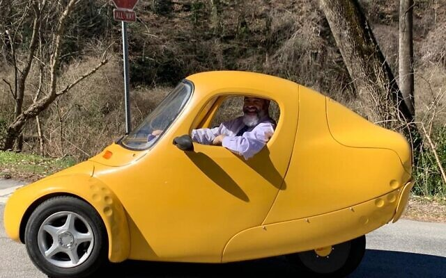 Rabbi Ilan D. Feldman in a yellow Corbin Sparrow.